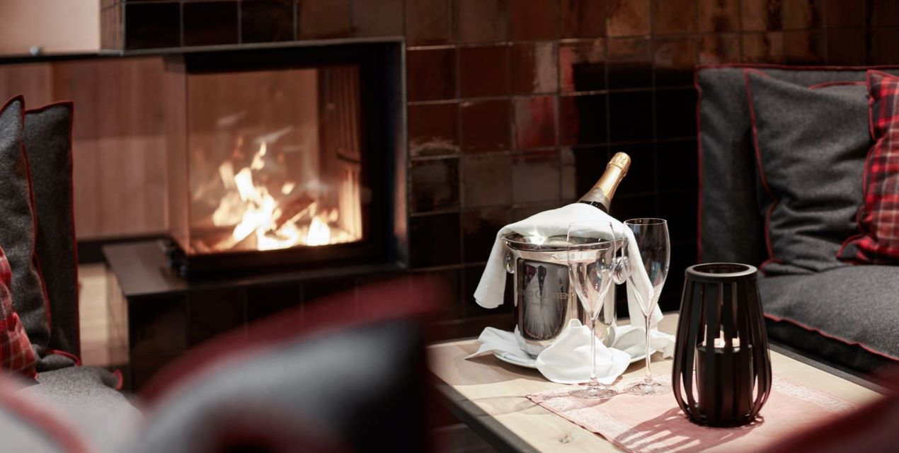 cosy open fire place with a bottle of champagne II