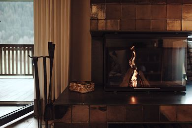 An open fireplace provides comfort