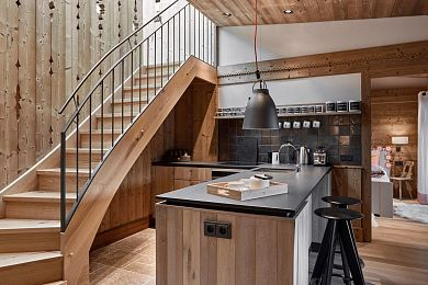 Fully equipped designer kitchen with stairs to a gallery bed